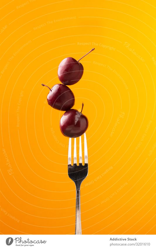 Composition of ripe red cherries on fork Cherry Fork composition Mature Red Tasty Juicy Bright Yellow Food Meal Delicious Sweet Fresh Dessert appetizing Fruit