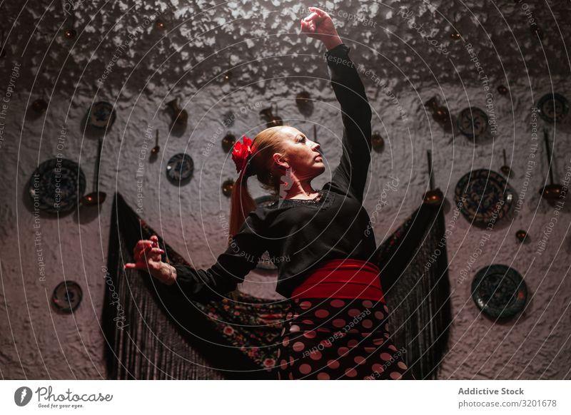 Woman dancer in flamenco costume standing in dance posture Flamenco tablao Dancer Skirt Beautiful Expression To enjoy Attractive Elegant Spanish Tradition