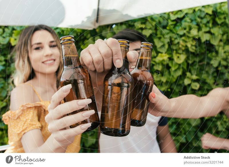 Group of friends drinking beer on the terrace of a bar Alcoholic drinks asian Autumn Bar Beach Beer Feasts & Celebrations Cheerful Toast Drinking Woman
