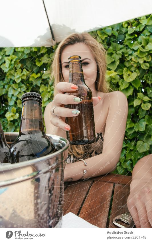 Blonde girl drinking beer on a terrace Adults Alcoholic drinks Autumn Background picture Bar Beautiful Beauty Photography Beer Caucasian Toast Cool (slang)