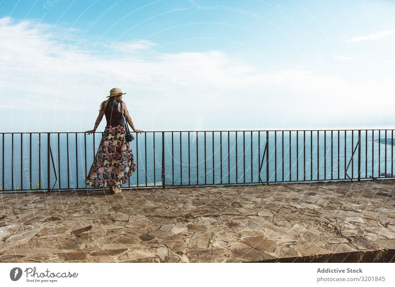 Stylish woman on terrace of seashore Woman seascape Style Summer Terrace Modern Fence Coast Vacation & Travel Contentment Leisure and hobbies Beautiful Idyll