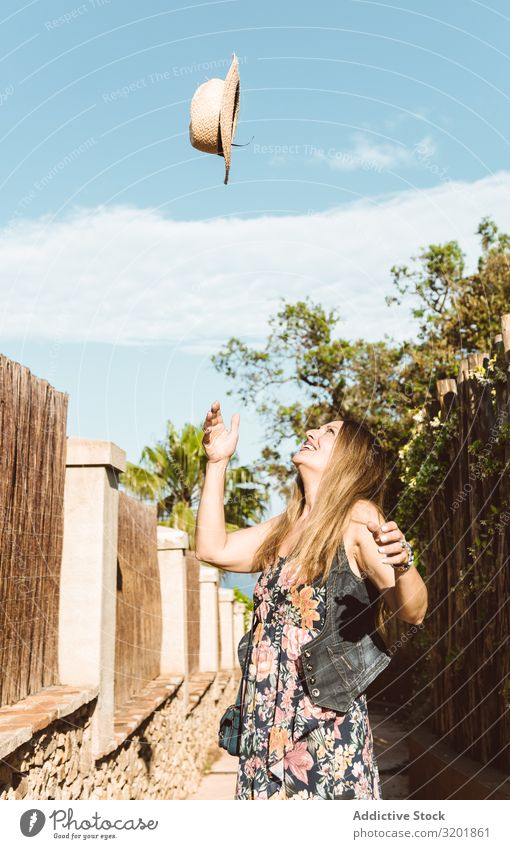 Happy woman throwing hat up Woman Straw hat Summer toss Vacation & Travel Cheerful Style Throw Tourism Emotions Expression Bright Beauty Photography Fly Smiling