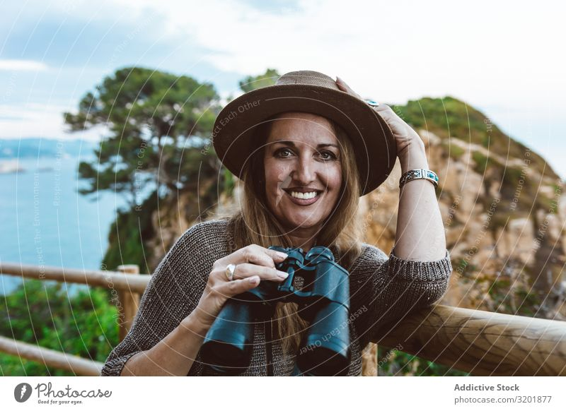 Woman with binocular on coastal walkway seascape Coast explore Vantage point Vacation & Travel Ocean Nature Tourism Adults Far-off places Observe marine
