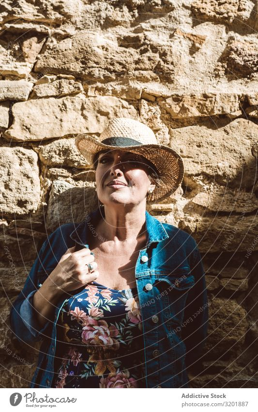Woman leaning in a wall in village Beautiful Dress Fashion Girl Happy Hat Lifestyle Exterior shot Human being Street Style Summer Tourism Tourist Town