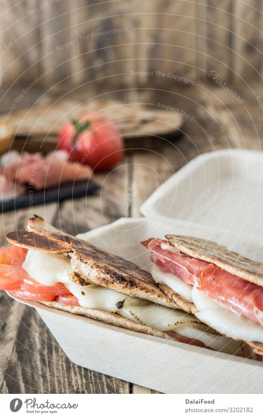 Piadina typical italian food Meat Cheese Vegetable Bread Nutrition Breakfast Lunch Dinner Vegetarian diet Diet Italian Food Wood Fresh Delicious Tradition