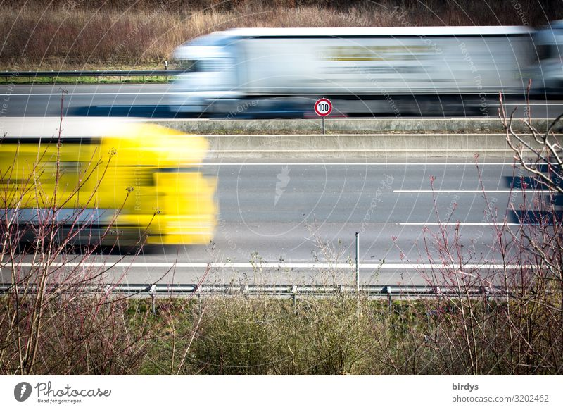 blurred I because too fast Climate change Transport Logistics Road traffic Motoring Highway Truck Road sign Speed limit 100 Driving Authentic Sustainability