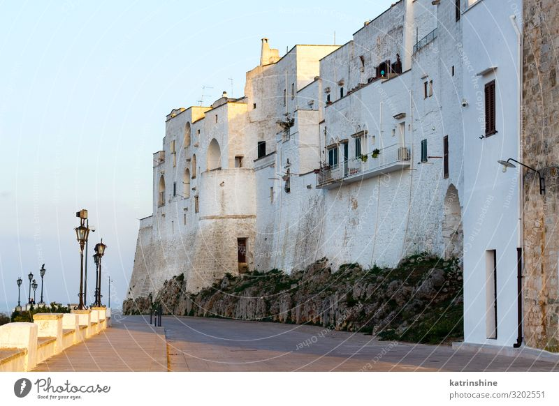 Outside white walls of the City of Ostuni, Apulia, Italy Vacation & Travel Town Building Architecture White Sunset painted città bianca white town