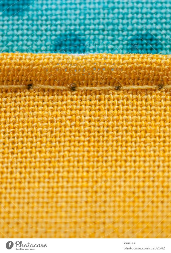 Macro shot: yellow and blue fabric with seam Clothing Stitching Linen Sewing thread Textiles Blue Yellow Structures and shapes Studio shot Detail