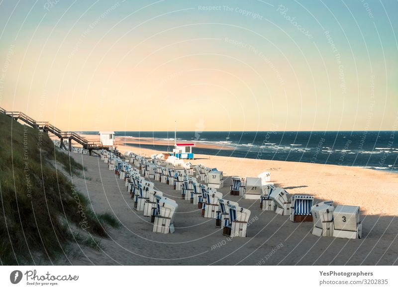 Beach landscape with wicker chairs in the morning on Sylt island Relaxation Vacation & Travel Summer Summer vacation Beautiful weather Coast North Sea Blue