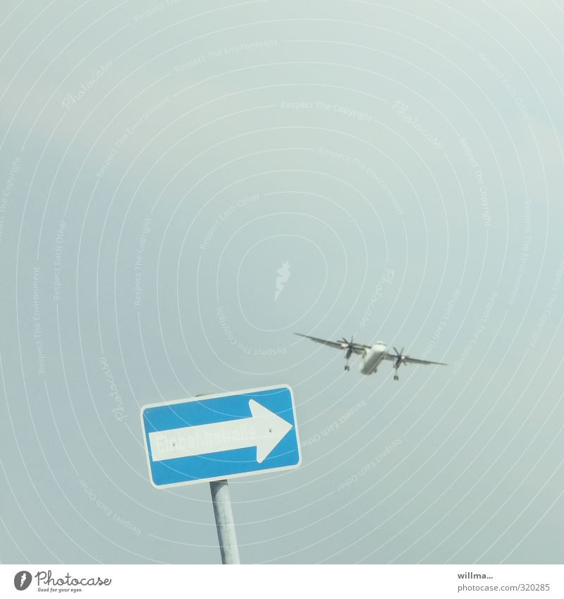 one-way street Vacation & Travel Aviation Airplane Signs and labeling Road sign Flying Blue Airplane landing Tilt Funny Road marking Groundbreaking Colour photo