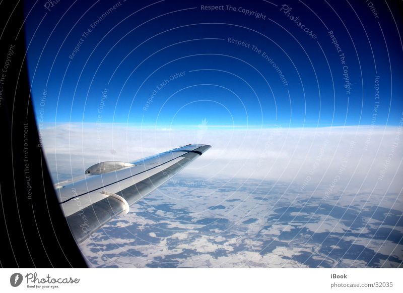 Sky Airplane Horizon Aviation Wing Beautiful weather Blue sky Snow layer