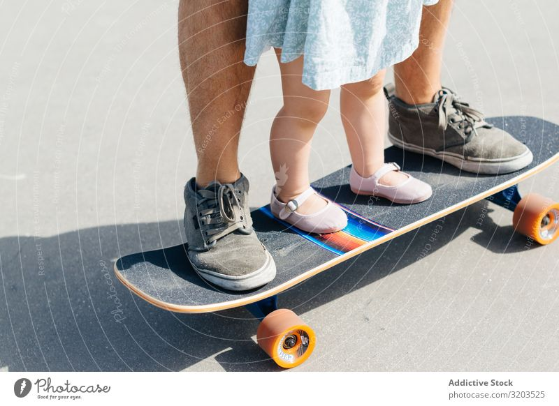 Crop father with infant daughter on skateboard Man Daughter Skateboard Family & Relations Father Small Child Dress Cute Ride Parents Sports Street Girl