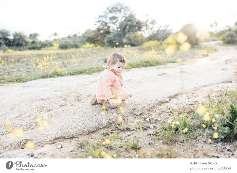 Adorable toddler girl on roadside Girl Baby Nature Strange Rural explore Small Street Rock Toddler Happy Child Infancy Cute Playful Sweet Summer Touch Sit