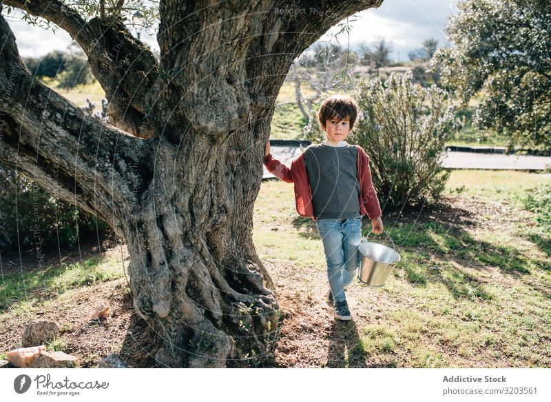 Kid with bucket walking on rural road Boy (child) Nature Landscape Street Bucket Summer Delightful Small Vacation & Travel Child Action Happy Infancy