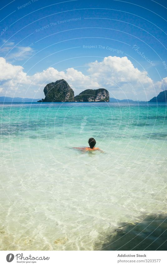 Traveler swimming in turquoise ocean water Vacation & Travel Float in the water Paradise Beach Thailand Water Relaxation Clear Lagoon Calm Tropical Summer Ocean
