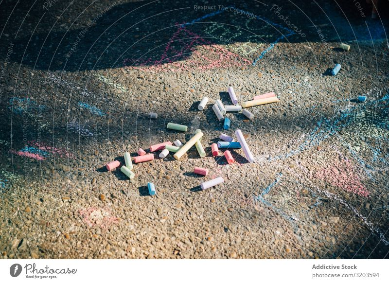 Colored chalk on pavement in sunny day Chalk Art Painting and drawing (object) Asphalt Creativity Street Playground Multicoloured Infancy Playing artistic