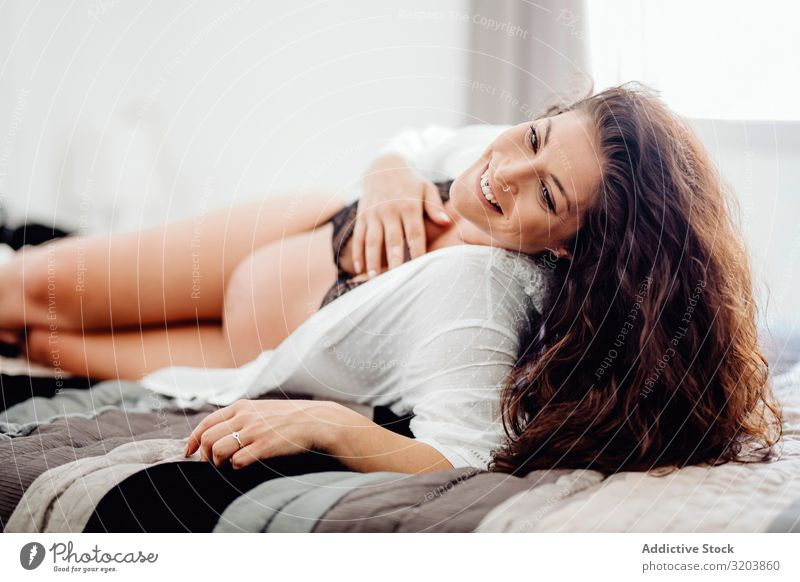 Pregnant female in underwear lying on bed Woman Underwear Showing one's bellybutton expecting Baby fetus Youth (Young adults) Human being Beautiful Attractive