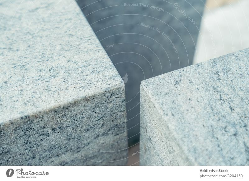 Angles of gray marble cubes Dice Marble angles Smooth Surface Beach zarautz Spain Stone Gray Block Material Solid mineral Detail element Exterior