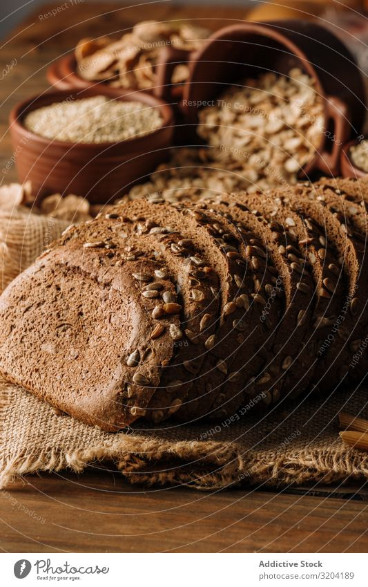 Freshly baked rye bread on napkin on table Horizontal Napkin Copy Space Delicious Culinary Cooking wholegrain Rustic Linen Organic Gourmet Ingredients Bakery