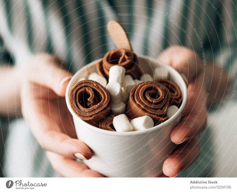 Hand holding rolled ice cream in cone cup Roll Rolled Ice cream Woman Cream Chocolate ice-cream Baking Fruit Frying copy Universe Copy Space Background picture