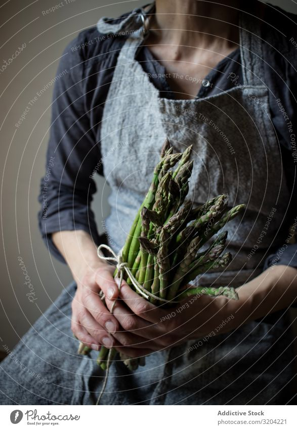 Faceless woman holding bundle of green asparagus Woman Asparagus Rustic Green Bundle Hand Hold Organic Diet Food Natural Nutrition Raw Ingredients