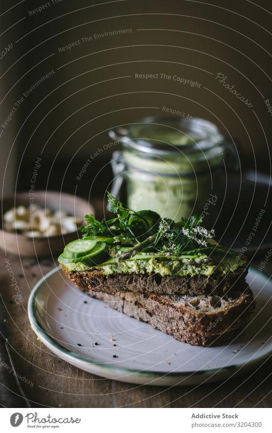 Toasts with cashew pate Paste Serve Vegan diet Green Spread Mint Vegetarian diet Cucumber jar Board Asparagus Meal Raw Nut Home-made Tasty Ingredients Wood Food