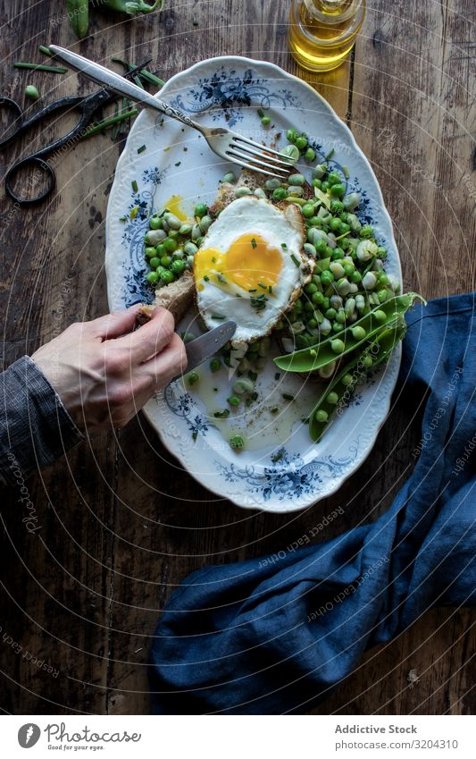 Delicious breakfast meal with steamed peas and egg Breakfast Peas Egg Frying sauteed served Eating Meal Beans Food Fresh Cooking Tradition Wood Raw Vegetable