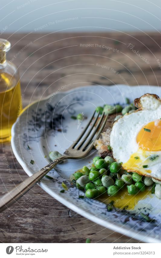 Delicious breakfast meal with steamed peas and egg Breakfast Peas Egg Frying sauteed served Eating Meal Beans Food Fresh Morning Cooking Tradition Edible