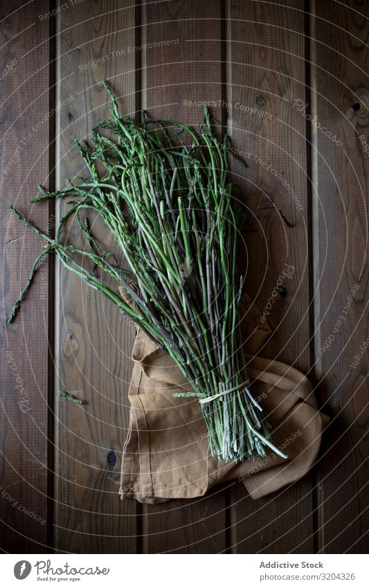 Fresh green asparagus Green Asparagus Organic Natural Food Bundle Cooking Delicious Nutrition Raw Mature Herbs and spices Leaf Rustic Table Vegetarian diet