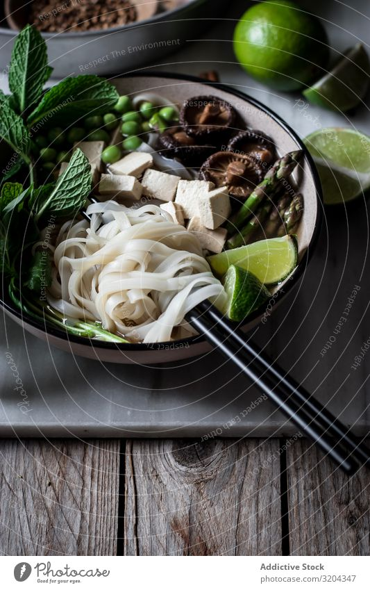 Pho soup with noodles Soup Vegetarian diet pho Mix Bowl Delicious Asian Food Cooking Dinner Tradition Tofu national Vegetable Table Chopstick Tasty Fresh