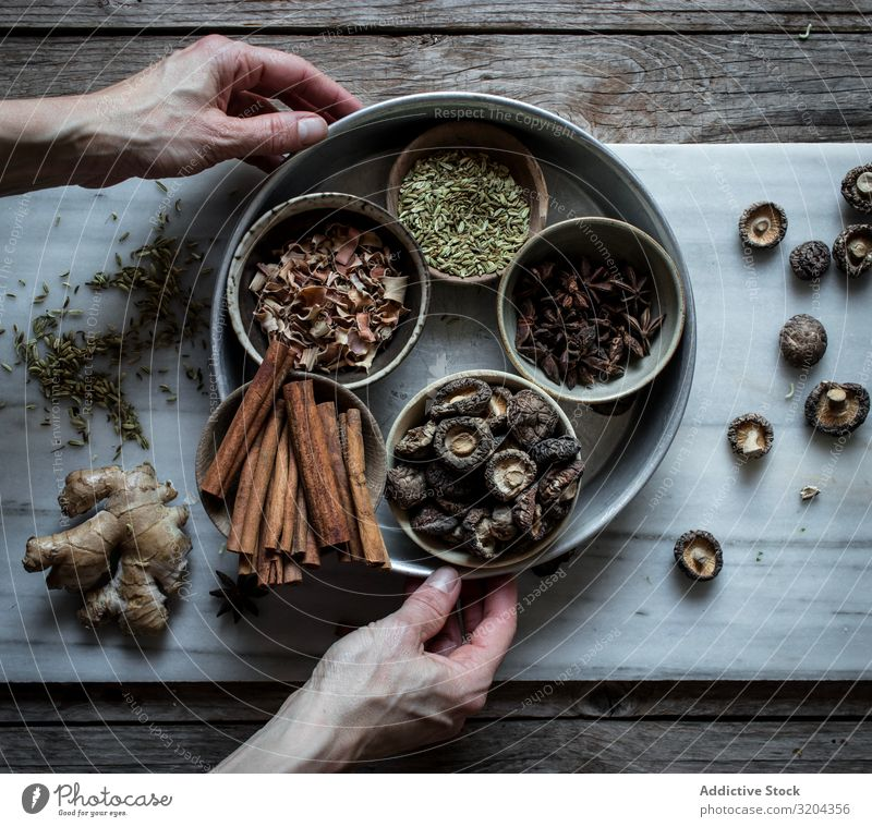 Spices and dry mushrooms on board Ingredients Herbs and spices Mix Dry pho Cooking Soup Mushroom seasoning Asian Food Organic anise Cinnamon Rustic Ginger
