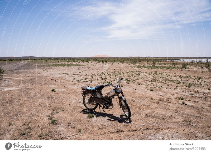 Motorcycle in spacious desert terrain Desert Tourism Morocco Sand Bicycle Lanes & trails Track Landscape Remote Loneliness Ground Sunlight Heat Sky Energy