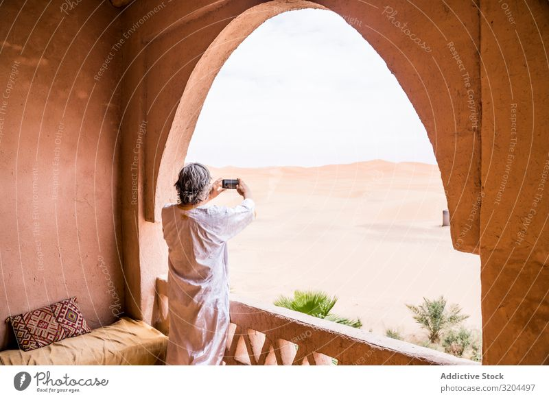 Man taking photo of desert from balcony Desert Balcony Morocco Vacation & Travel Vantage point PDA Landscape Heat Exotic oriental Tourism Nature Tourist Terrace