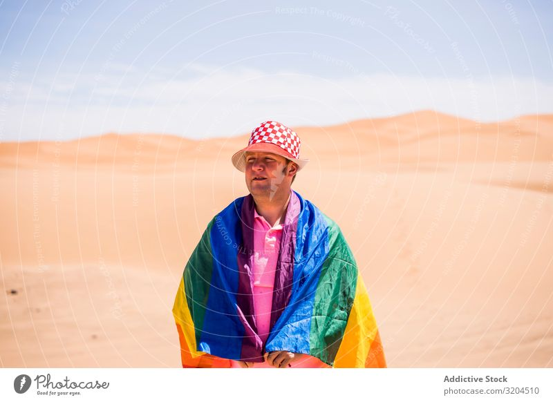 Gay standing in desert Homosexual Man lgbt Flag Desert Mature Love Middle-aged tolerance Laws and Regulations Pride Alternative Symbols and metaphors Rainbow