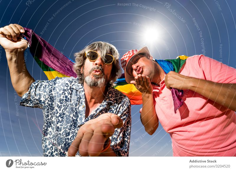 Excited plump gay couple in desert Homosexual Couple lgbt Flag Desert Excitement Mature Man Love boyfriends husbands Middle-aged tolerance Laws and Regulations