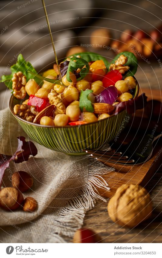 Bright vegetables with chickpeas in bowl and walnuts Chickpeas Walnut Nut Vegetable Healthy Food Organic Vegan diet appetizing Green Salad Raw Eating Meal Fresh