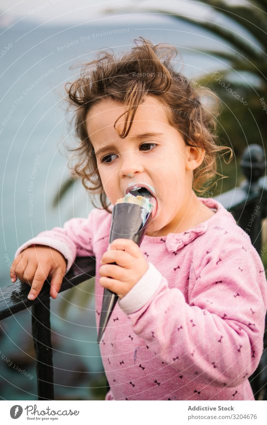 Adorable serious toddler girl with ice-cream Girl Toddler Ice cream Earnest Delightful Charming Pensive Eating Portrait photograph Infancy Child Innocent