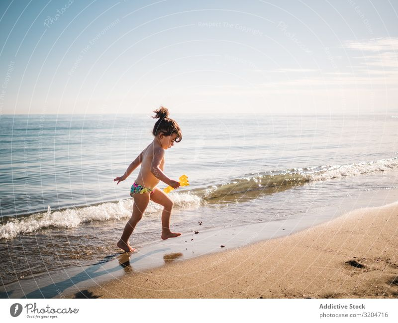 Toddler girl walking on sandy beach Girl Beach Walking Playing Child Swimming Sand Ocean Calm Infancy Summer Vacation & Travel Sunbeam Water seaside Coast