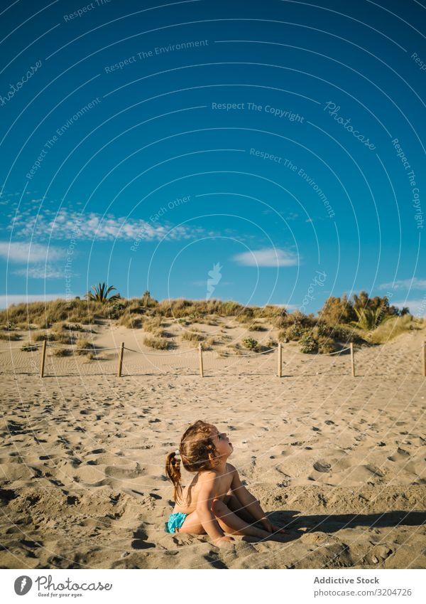 Girl playing on beach in sunny day Beach Playing Sunbeam Day Toddler Sand Delightful seaside Coast Infancy Serene Vacation & Travel Action Sunbathing Child