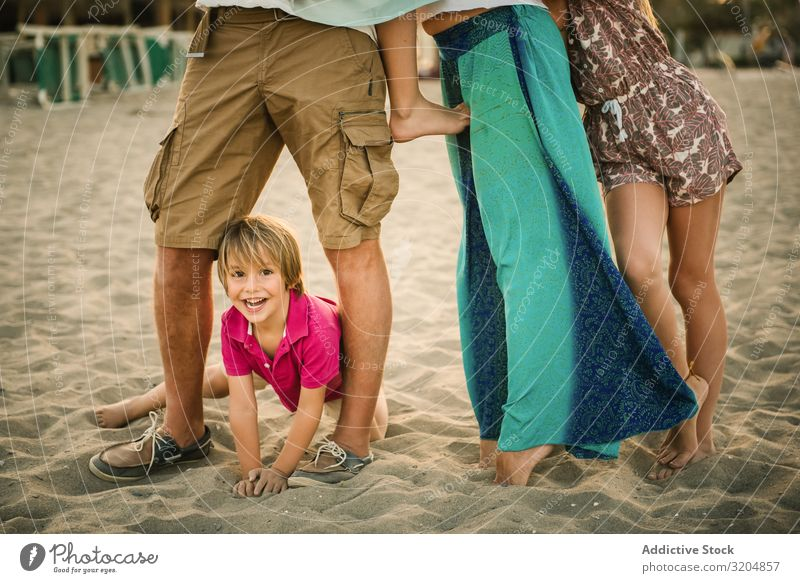 Crop parents with kids on beach Family & Relations Beach Love Group Parents Child Boy (child) Girl Happy Delightful Playful sibling Summer Vacation & Travel