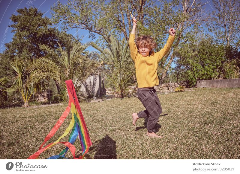 Boy launching kite on summer day Boy (child) Kite Sky Joy Infancy Playing Flying Landscape Child Small Human being Action Playful Easygoing Recklessness