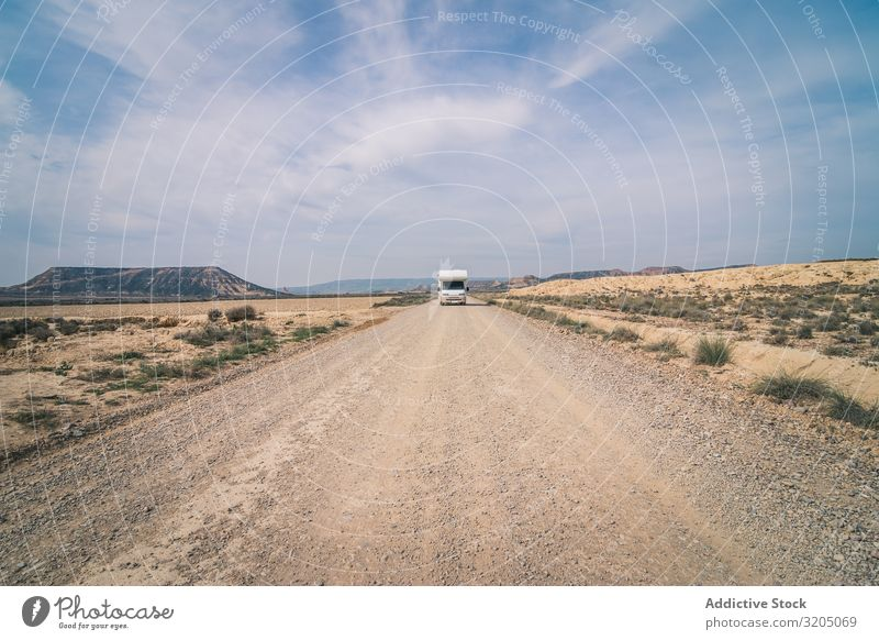White trailer on empty road along desert Trailer Desert Amazing Empty Street Vacation & Travel Caravan Landscape Nature Speed Asphalt Trip semi Adventure