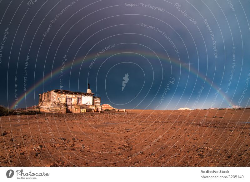 Lonely house in desert and rainbow in sky Desert Rainbow Hill Landscape Sand Stone Plant Multicoloured Dry Nature Sky Vacation & Travel Hot Colour Dune Tourism