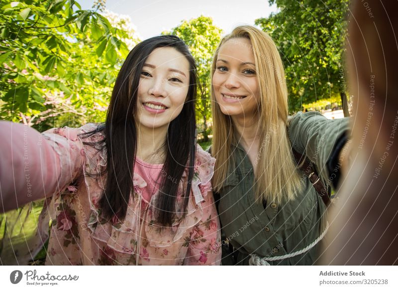 Multiracial friends taking selfie in park Friendship Selfie Park Smiling Mixed race ethnicity Together Youth (Young adults) Woman Lifestyle Leisure and hobbies
