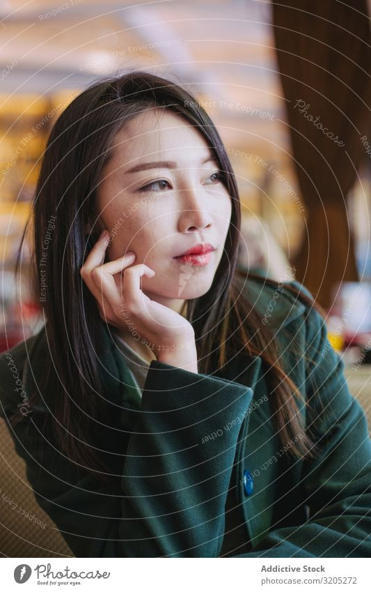 Portrait of young asian woman looking away Woman Café Table Sit Youth (Young adults) To enjoy Lifestyle Leisure and hobbies Rest Relaxation Ethnic Style