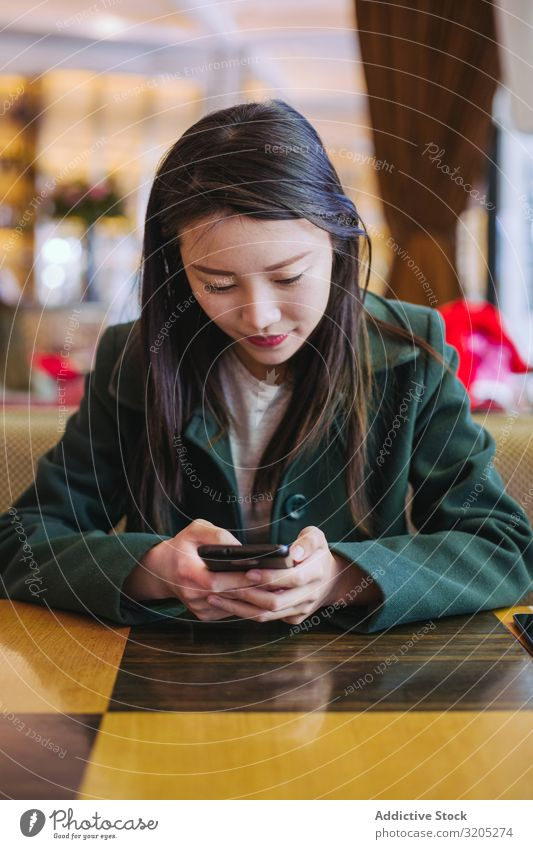 Asian woman using smartphone in cafe Woman PDA Café Sit Table asian Cozy Lifestyle Leisure and hobbies Ethnic Rest Relaxation Style Hip & trendy Elegant