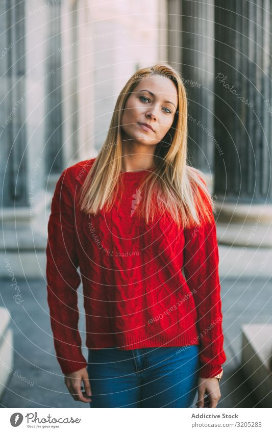Stylish female standing near marble columns Woman Portrait photograph Looking into the camera Street City Youth (Young adults) Column Style Building Marble