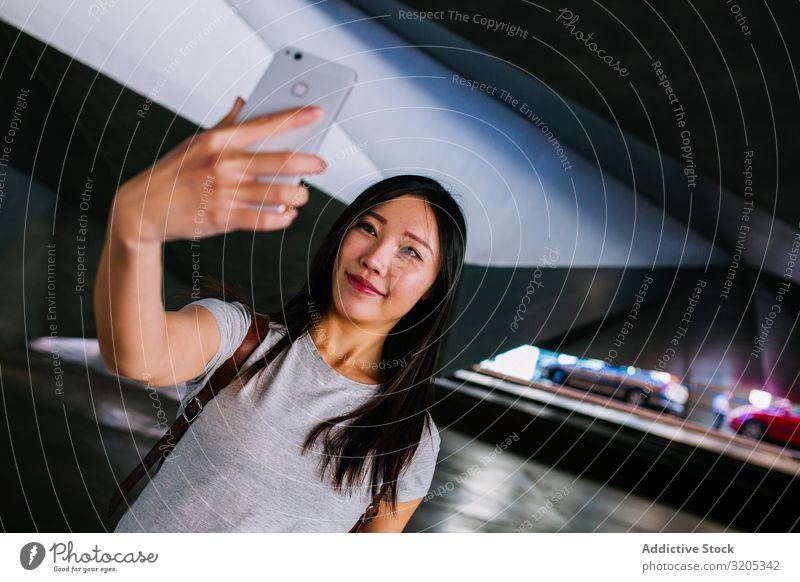 Asian female taking selfie in underground passage Woman Selfie Underground Passage Posture Smiling asian Youth (Young adults) PDA Easygoing Town grungy Parking