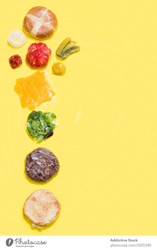 Ingredients of a cheese burger wrapped in plastic Barbecue (event) BBQ Beef Bread Roll Cheese Conceptual design flat lay Food Hamburger Ketchup Lettuce Meat