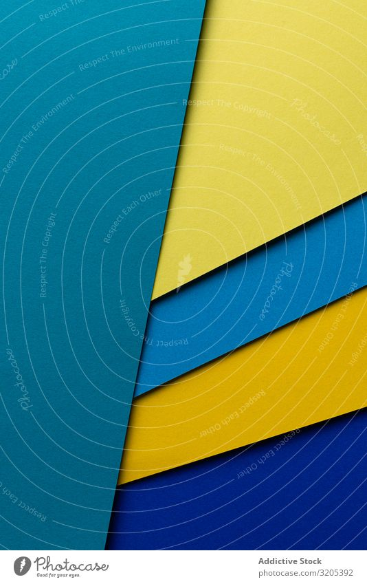 Arranged sheets of colorful carton layout blue yellow background tone blocking shade cardboard surface material design texture trend simple minimalist paper